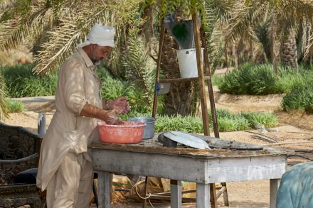 Image of date farm worker preparing lunch