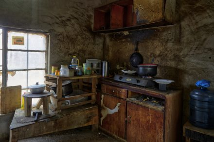 Image of a pan on a cooker in a date farm workers' kitchen