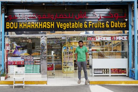 Image of date market shop and sales person