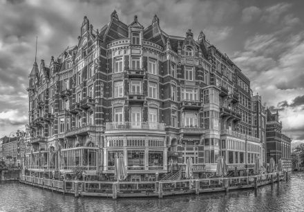 Architectural photography image of the Hotel de L'Europe in Amsterdam, The Netherlands, taken from across the Amstel river