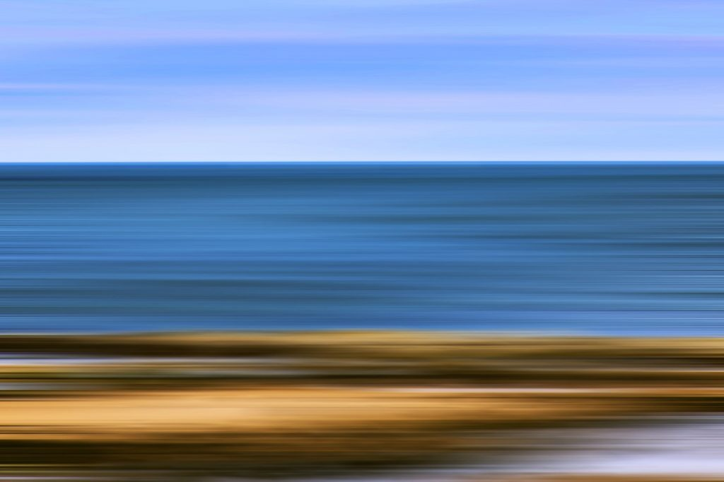 Digitally enhanced image of beach, sea, and sky, at WHitley Bay, Tyne and Wear, UK, offered as non-fungible token (NFT)
